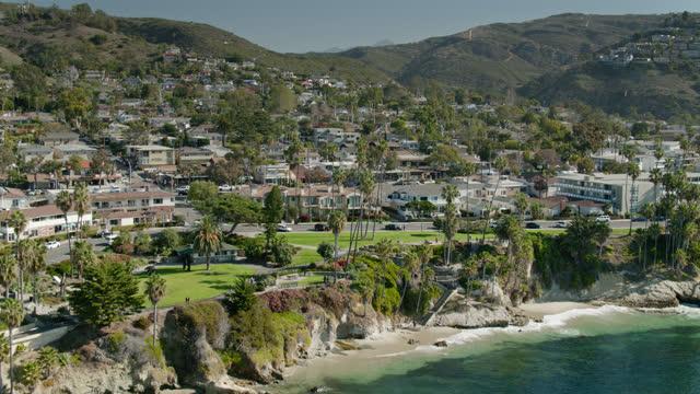 upward tilting drone flight towards santa ana mountains over laguna beach - laguna beach california stock videos & royalty-free footage