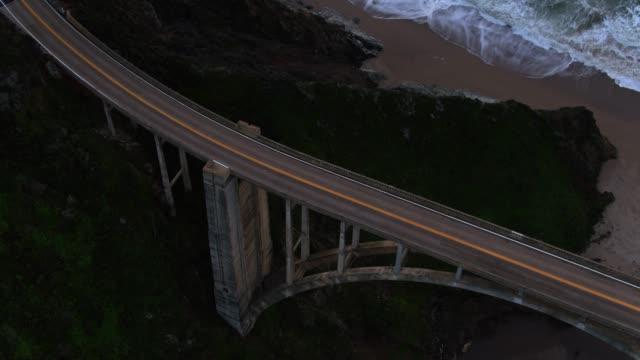 upward tilting drone shot of bixby creek bridge - bixby creek bridge stock videos & royalty-free footage