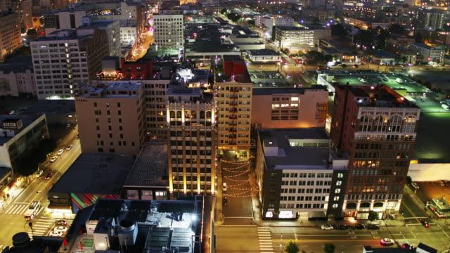 Upward Tilting Drone Shot of Downtown LA Fashion District at Night