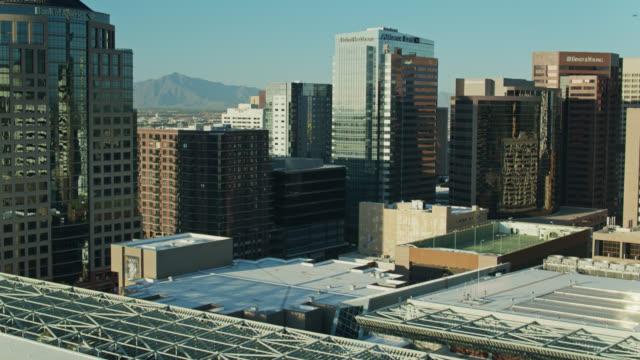 upward tilting drone shot of downtown phoenix - phoenix arizona stock-videos und b-roll-filmmaterial