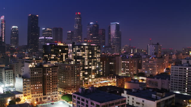 Upward Tilting Drone Shot of DTLA Fashion District and Financial District at Night