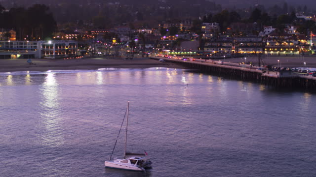 upward tilting drone shot of sant cruz at dusk - santa cruz california stock videos and b-roll footage