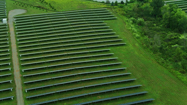 upward tilting drone shot of solar power station in michigan - 30 seconds or greater stock videos & royalty-free footage