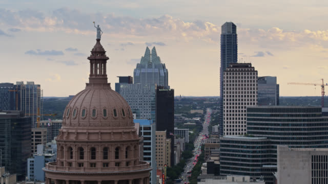 upward tilting drone shot of the texas state capitol building - texas state capitol building stock videos & royalty-free footage