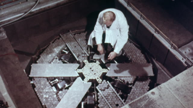 1957 montage uranium 235 rod being removed from the reactor and removed safety / harwell, oxfordshire, england - nuclear power station stock videos & royalty-free footage