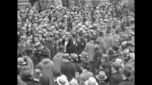 Urbain Ledoux a/k/a 'Mr Zero' makes his way though a large New York City crowd accompanied by his numerous followers both black and white