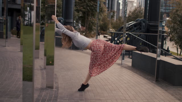 urban dancer among modern architecture - balance stock videos & royalty-free footage