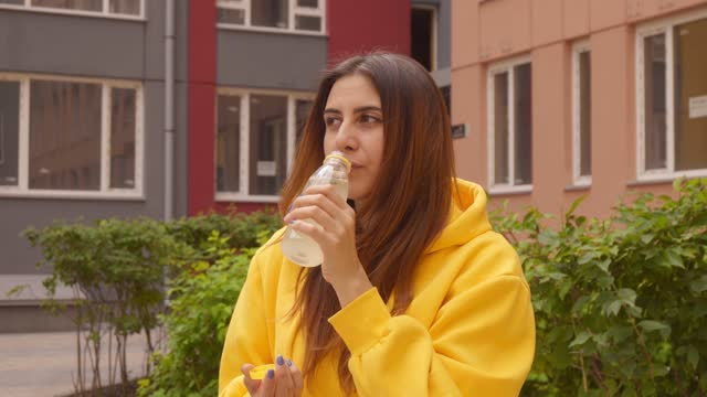 urban girl drinking juice bottle - on the move stock videos & royalty-free footage