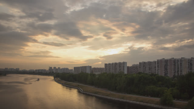 Urban landscape with sunset in the clouds above the residential district with residential apartment buildings