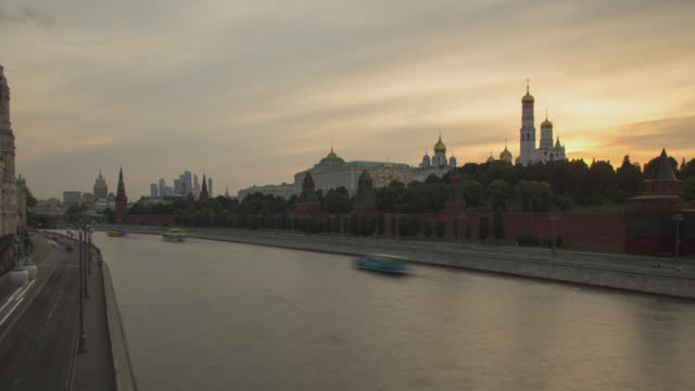 Urban landscape with the Moscow river in the foreground and the Moscow Kremlin in the background at sunset
