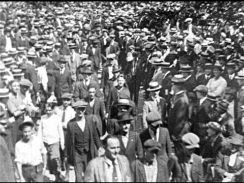 stockvideo's en b-roll-footage met urban ledoux walking w/ men through crowd of people 'mr zero' 'auctioning' young adult male on stage for human labor ws crowd ms woman on stage... - 1921