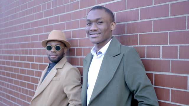 urban lifestyle portrait of two young black african male friends talking together - only men stock videos & royalty-free footage