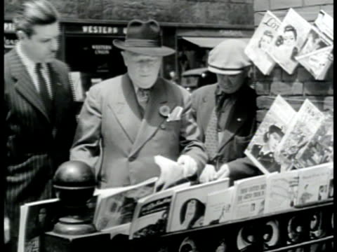 DRAMATIZATION Urban man buying paper at newsstand headline 'London Expects Invasion Of Europe At Any Hour' man saying SOT that they can't do a thing...