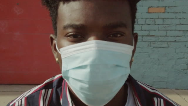 urban people black male outdoors wearing face mask during pandemic virus outbreak 4k video series - portrait stock videos & royalty-free footage