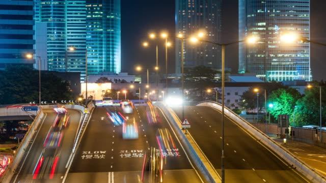 vídeos de stock, filmes e b-roll de t/l urban roads at night, hong kong - ilha de hong kong