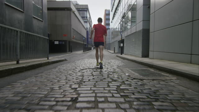 urban running. - smooth stock videos and b-roll footage