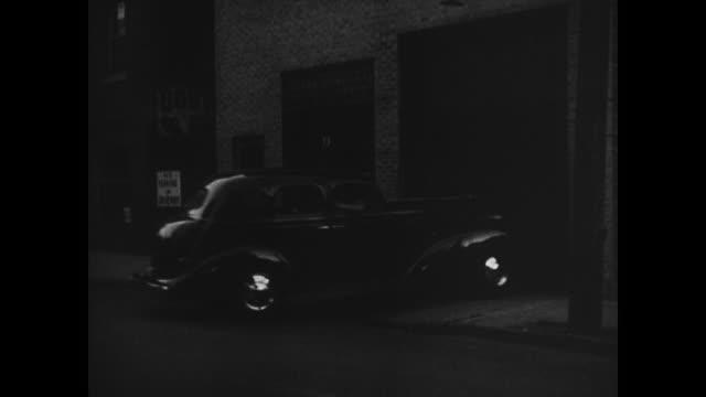 night urban side street garage door opening new automobile w/ suicide doors moving into garage garage door closing criminal activity clandestine... - 1936 stock videos and b-roll footage