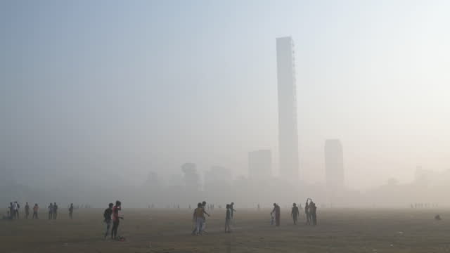urban skyline in heavy smog in kolkata, west bengal, india, on monday, december 7, 2020. - smog stock videos & royalty-free footage