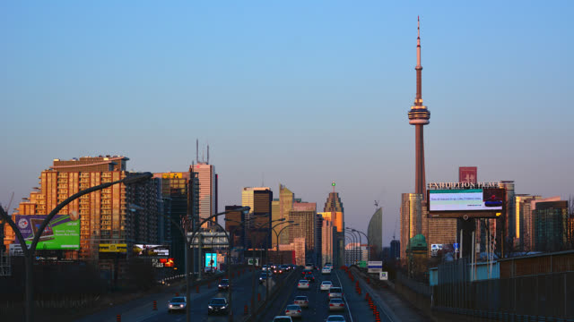 urban skyline with business signs seen from the gardiner expressway on may 1 in toronto, ontario, canada. the gardiner expressway enters the downtown... - direction stock videos & royalty-free footage