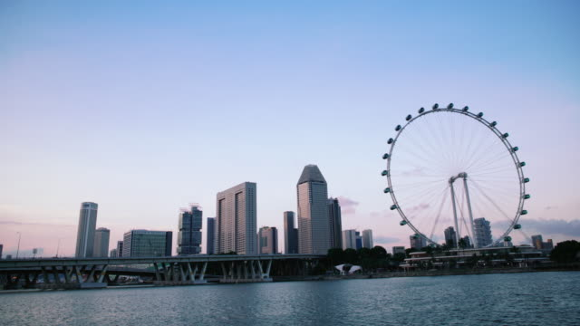ws tl urban skyline with singapore flyer. - singapore flyer stock videos and b-roll footage