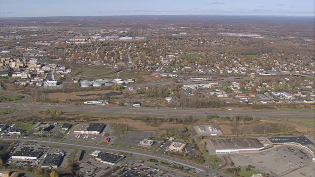 aerial urban sprawl and suburbs among grassy landscape / syracuse, new york, united states - syracuse stock videos & royalty-free footage