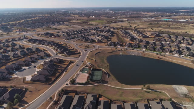 urban sprawl. georgetown, the suburban residential area of austin, texas.aerial drone video with panoramic camera motion. - georgetown texas stock videos & royalty-free footage