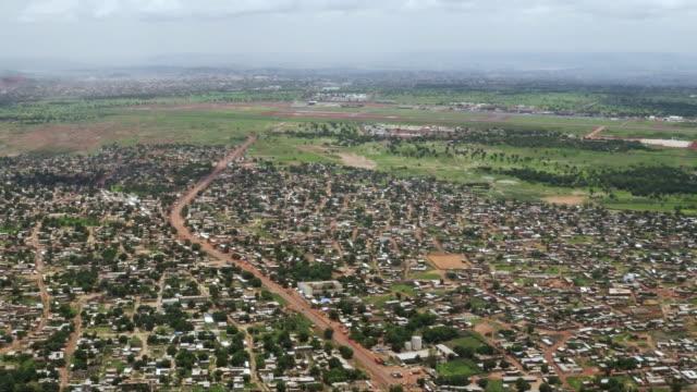 urban sprawl of lagos, nigeria, aerial view - nigeria stock videos & royalty-free footage