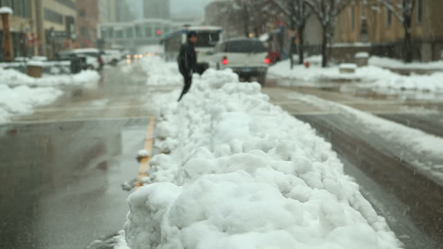 urban street scene during winter snowstorm - minnesota stock videos & royalty-free footage
