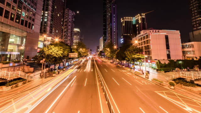 t/l ws pan urban traffic at night / shenzhen,china - traffic点の映像素材/bロール