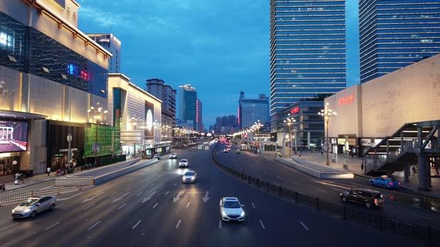 urban traffic scene in bayi square, nanchang, jiangxi - china east asia stock videos & royalty-free footage