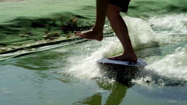 urban wakeboarding. close up on legs - wakeboarding stock videos and b-roll footage