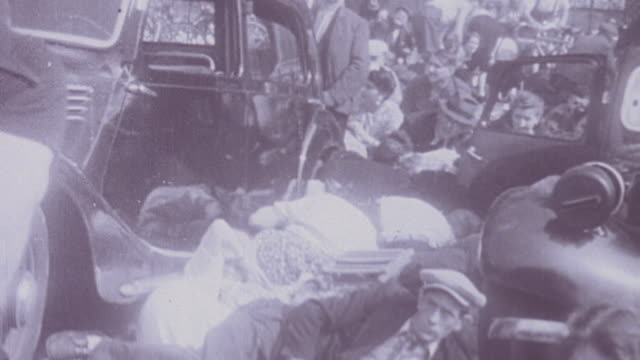 urban warfare during the liberation of paris civilians taking cover behind cars and buildings soldiers firing collaborators being rescued by police... - prigioniero di guerra video stock e b–roll