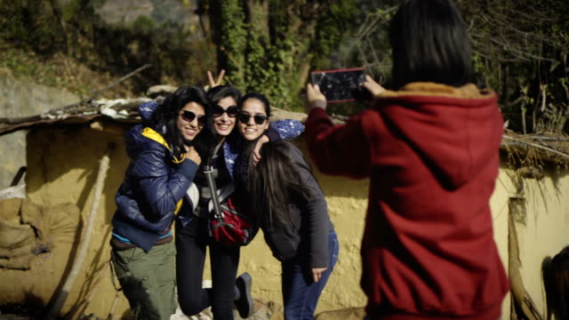 urban young women taking pictures, having fun in a village. - exploration stock videos and b-roll footage