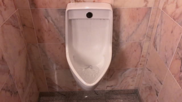 urinal in restroom - urinal stock videos & royalty-free footage