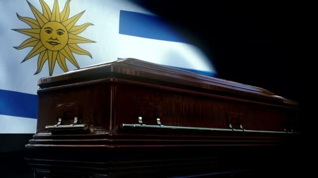 uruguaian flag behind coffin - uruguaian flag stock videos & royalty-free footage