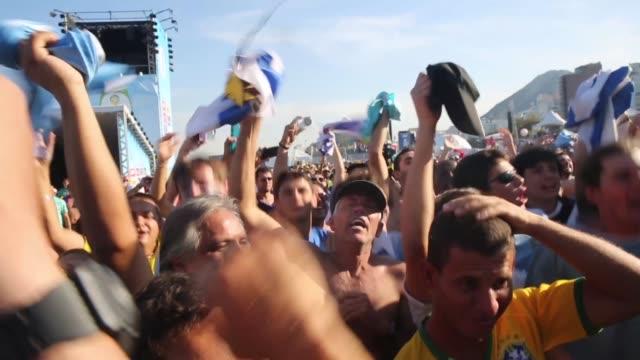 uruguay fans celebrate a victory at the fifa fan fest on copacabana beach on june 24, 2014 in rio de janeiro, brazil. - uruguay stock videos & royalty-free footage