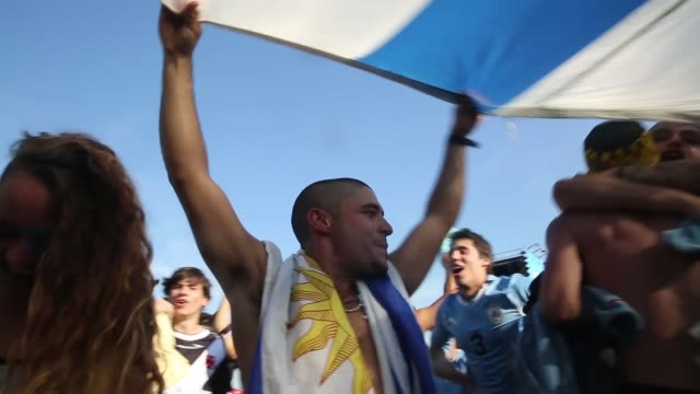 PAN Uruguay fans celebrate a victory at the FIFA Fan Fest on Copacabanaa Beach on June 24 2014 in Rio de Janeiro Brazil