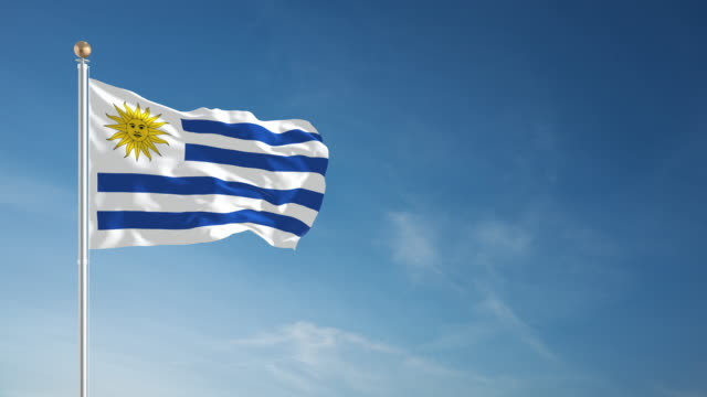 4k uruguay flag - loopable - uruguay stock videos & royalty-free footage