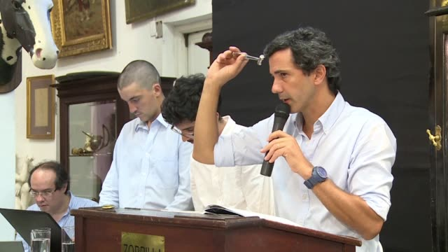 uruguayan collectors gather at an auction house in montevideo to bid on a several artefacts including many reflecting the rich football culture of... - montevideo stock videos & royalty-free footage