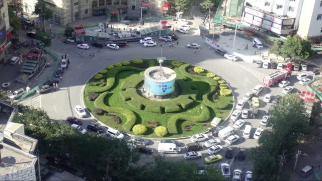 urumchi city crossroad ,xinjiang province , china - 新疆ウイグル自治区点の映像素材/bロール