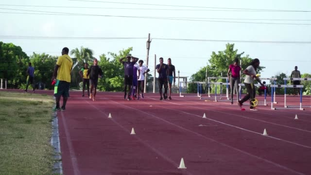 vídeos de stock, filmes e b-roll de usain bolt is leaving some pretty fast footsteps to follow but he couldn't have achieved the title of world's fastest man if he hadn't attended one... - bolt