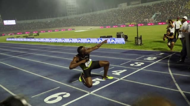 usain bolt partied with his devoted fans in an emotional farewell at the national stadium on saturday as the worlds fastest man ran his final race on... - bolt stock videos & royalty-free footage