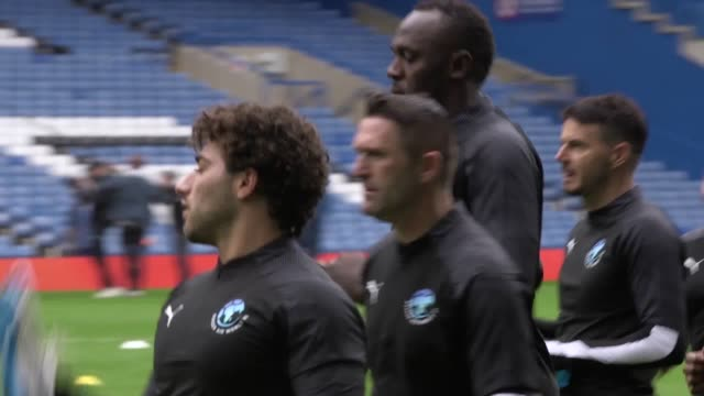 usain bolt trains with fellow soccer aid participants at stamford bridge ahead of the charity football match on sunday june 16 - soccer association stock videos & royalty-free footage
