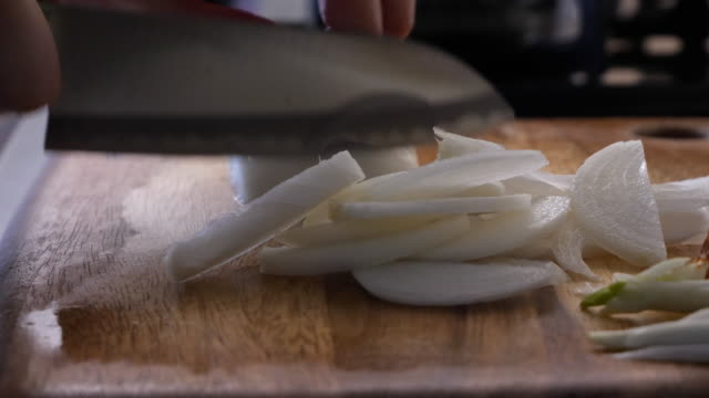 use a knife to cut the onions. - generic location stock videos & royalty-free footage