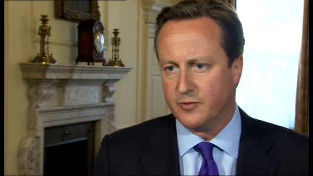 david cameron makes case for military strikes england london downing street int david cameron interview sot any action we take or others take will... - 武力攻撃点の映像素材/bロール
