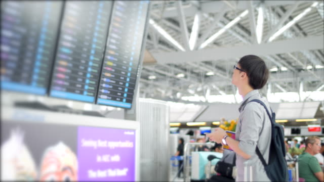 Use phone for check flight at the airport