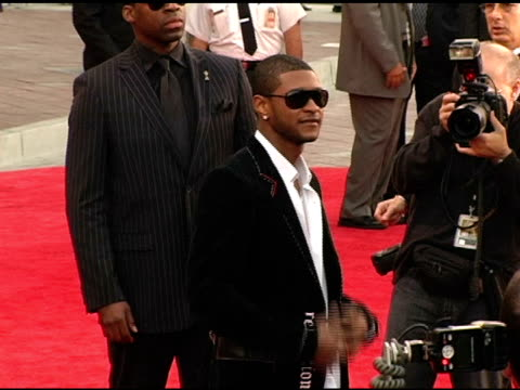 usher at the 2004 american music awards red carpet at the shrine auditorium in los angeles, california on november 14, 2004. - usher stock videos & royalty-free footage
