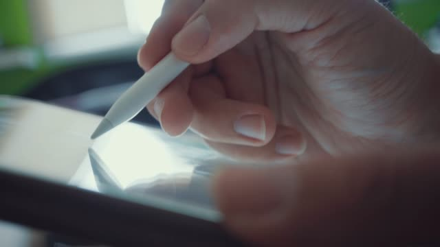 using a digital pencil with graphic tablet,close-up - pen stock videos & royalty-free footage