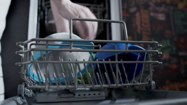 using a dishwasher - washing up stock videos & royalty-free footage