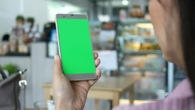 Verwenden eine Smartphone mit der Green-Screen